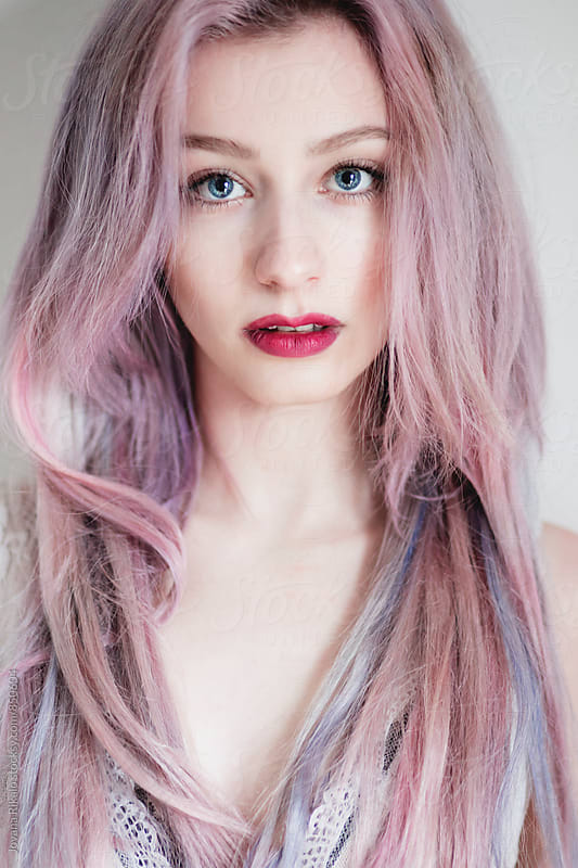 Portrait of a beautiful young woman with blue eyes and pink hair  by Jovana Rikalo for Stocksy United
