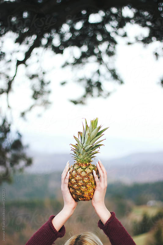 Woman holding pineapple by Jovana Rikalo for Stocksy United