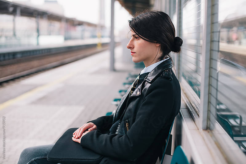Woman waiting for a metro by Marija Mandic for Stocksy United