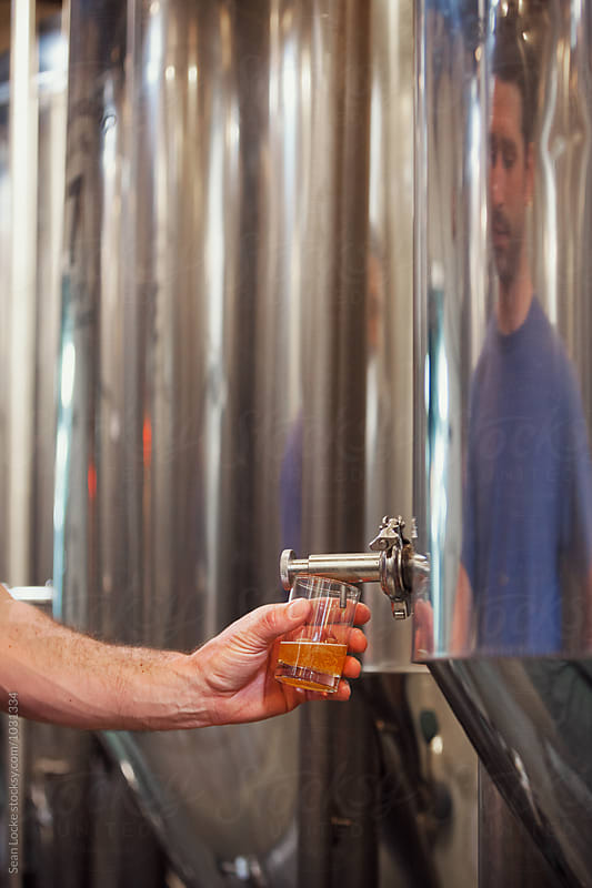 Beer: Brewer Taking Sample To Check Color And Taste by Sean Locke for Stocksy United