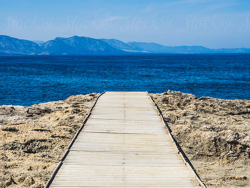 boardwalk to the cliff in Sardinia, Italy by Juri Pozzi for Stocksy United