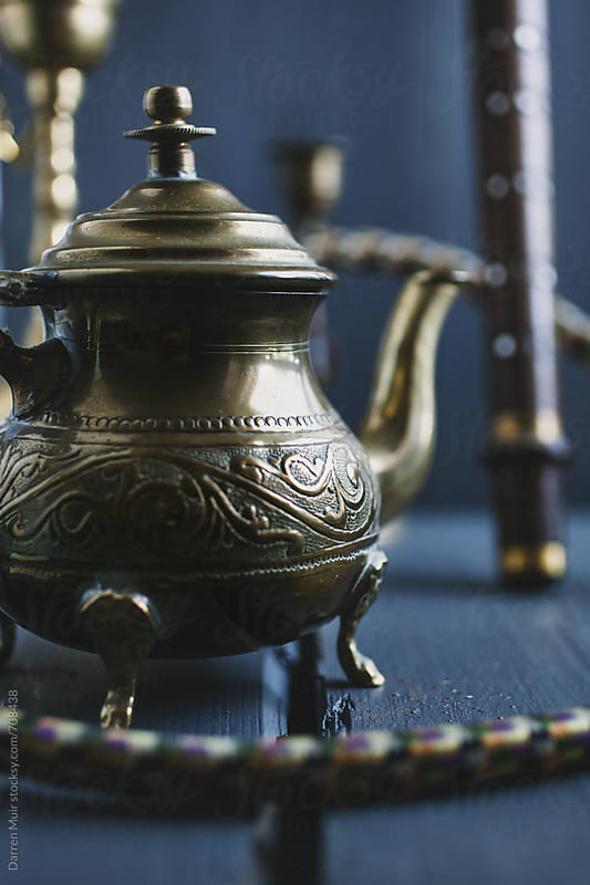 Ornate north African brass teapot. by Darren Muir for Stocksy United