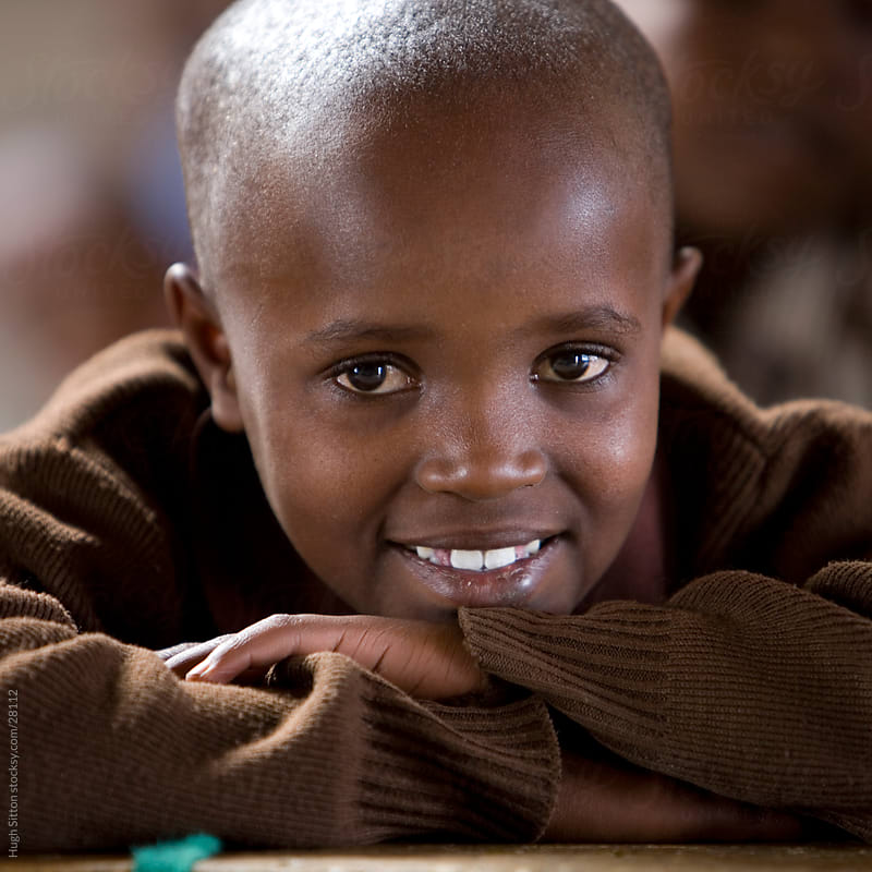 Young smiling schoolboy. Kenya by Hugh Sitton for Stocksy United