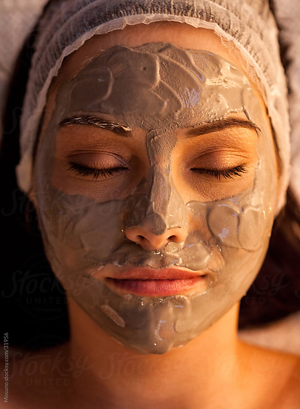 Woman with a facial mask in a spa center. by Mosuno for Stocksy United