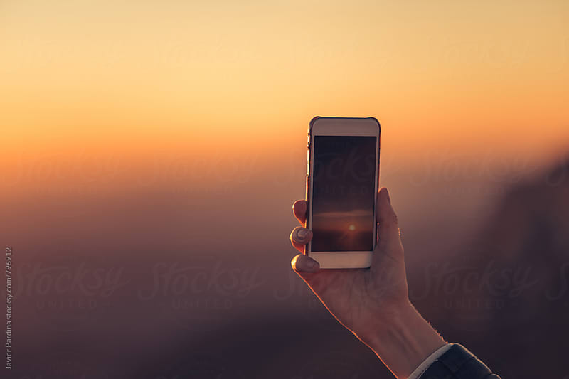 taking photos at sunset by Javier Pardina for Stocksy United