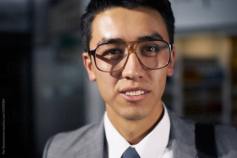 Portrait of young entrepreneur wearing cool glasses by Per Swantesson for Stocksy United