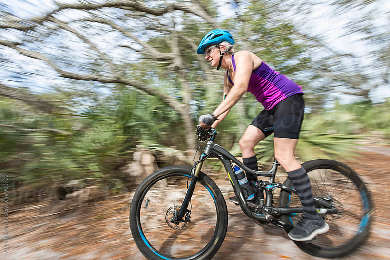 Female mountain biker riding the trails by Adam Nixon for Stocksy United