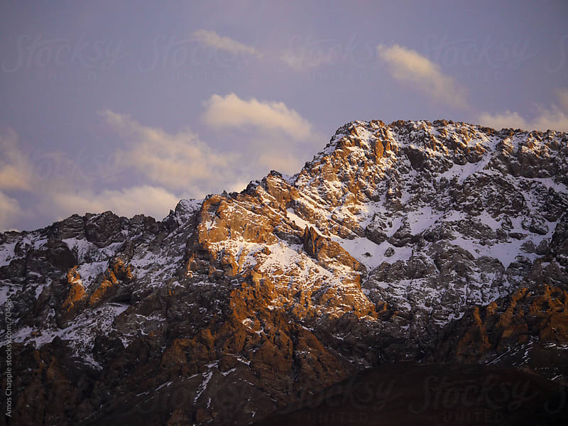 An unnamed mountain in the Pamirs caught in evening sunlight.  by Amos Chapple for Stocksy United