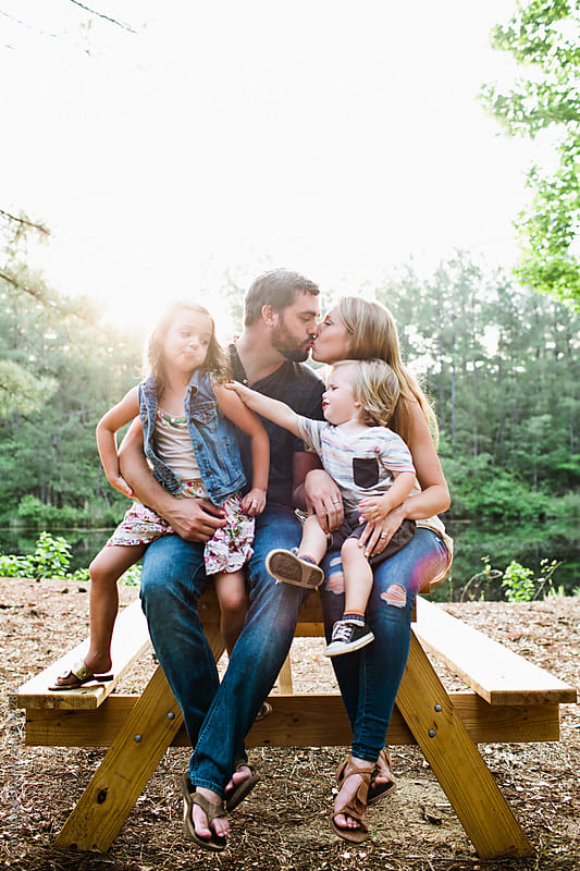 Family on Picnic Table by Erin Drago for Stocksy United
