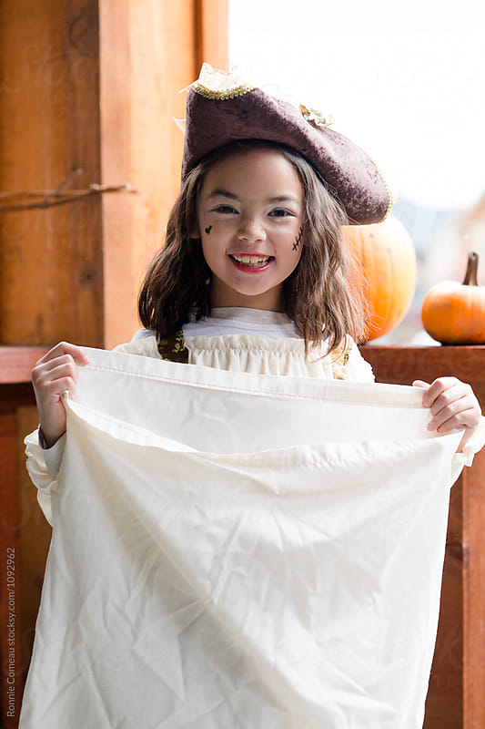 Little Pirate Girl on Halloween by Ronnie Comeau for Stocksy United