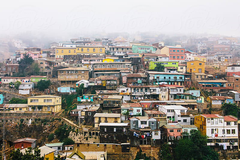 Slums cityscape view of colourful houses with mist in Valparaiso, Chile by Alejandro Moreno de Carlos for Stocksy United