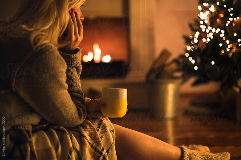 Woman Drinking Tea on Christmas Eve by Lumina for Stocksy United