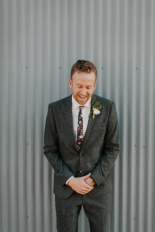 Groom Laughing by Sidney Morgan for Stocksy United