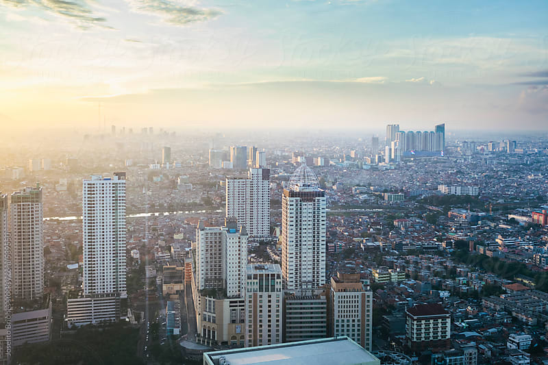 Aerial View of High-rise Buildings in Urban Sprawl of Modern Jakarta Indonesia by Joselito Briones for Stocksy United