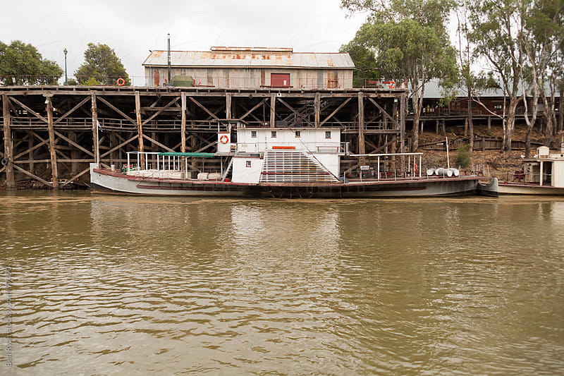 Vintage paddle steamer moored at timber wharf by Ben Ryan for Stocksy United