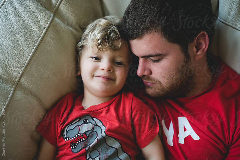 Daddy son snuggles by Courtney Rust for Stocksy United