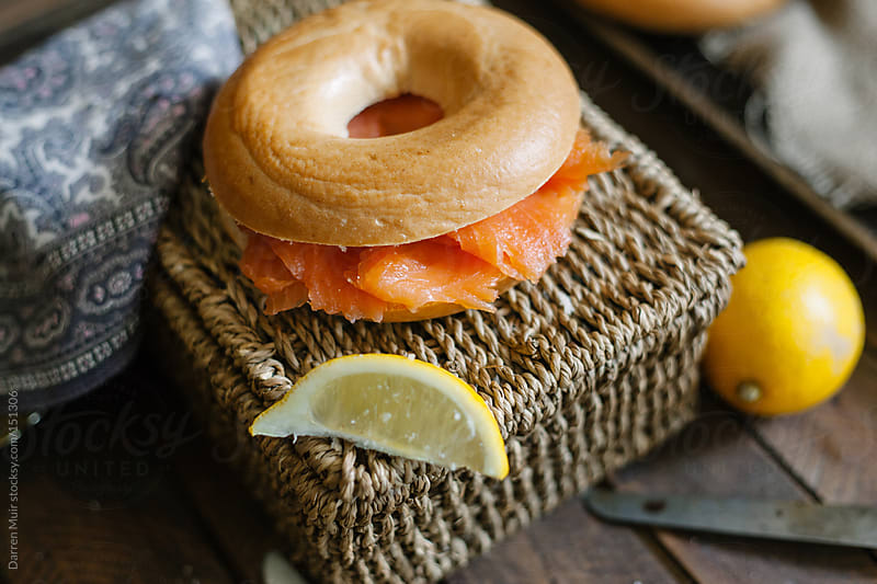 Smoked salmon bagel.  by Darren Muir for Stocksy United