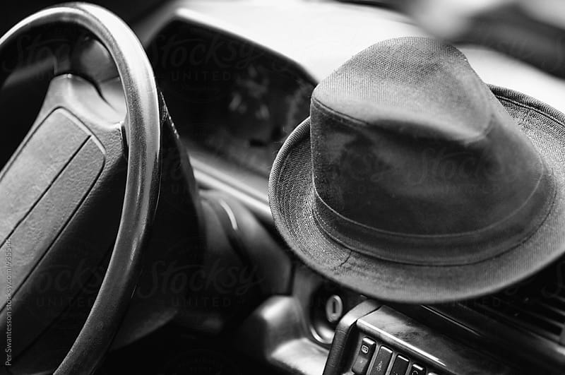 Vintage car with hat on the dashboard by Per Swantesson for Stocksy United