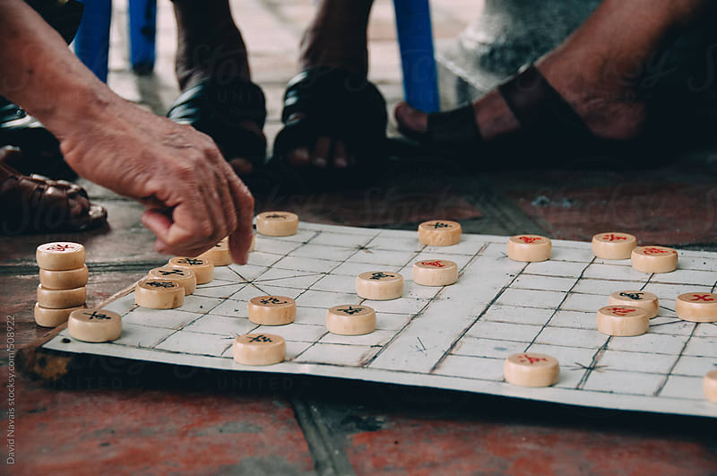 Playing a board game in Hanoi by David Navais for Stocksy United