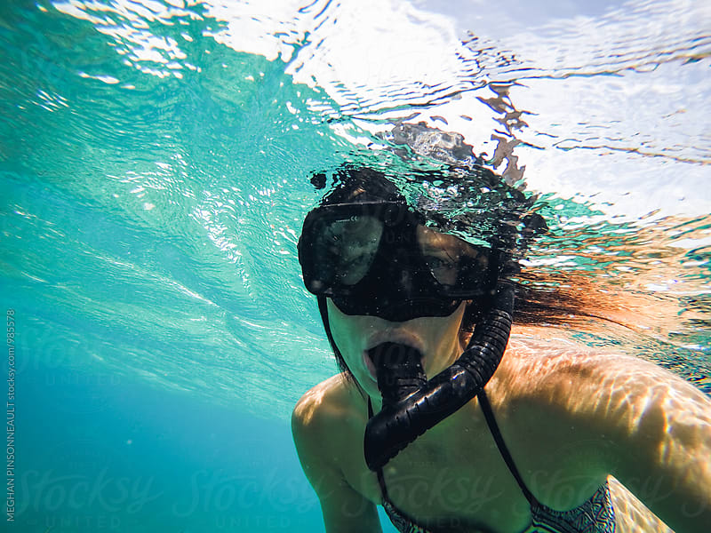 Female Snorkeling in Tropical Blue Water by MEGHAN PINSONNEAULT for Stocksy United