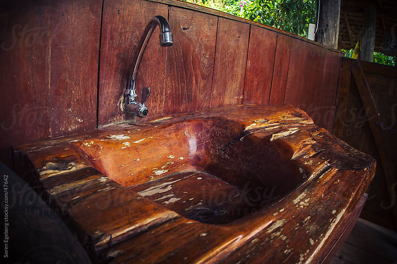 Worn brown wooden sink inside nature house by Soren Egeberg for Stocksy United