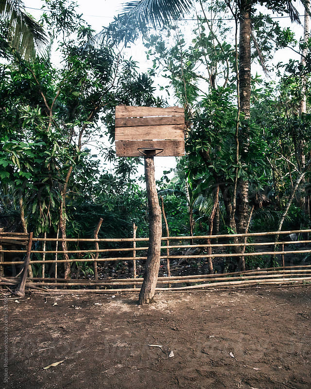 a makeshift basketball net in a rural Filipino Village by Shaun Robinson for Stocksy United