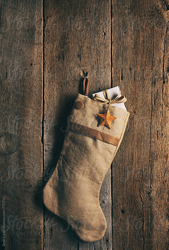 Rustic: Christmas Stocking with Gift Inside by Sean Locke for Stocksy United