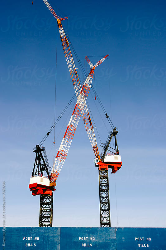 Dual Construction Cranes by Raymond Forbes LLC for Stocksy United