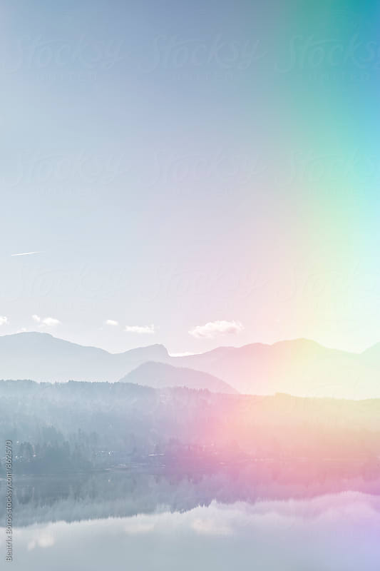 Double exposure of an Austrian landscape and colorful light source by Beatrix Boros for Stocksy United