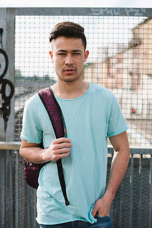 Handsome asian man portrait by Simone Becchetti for Stocksy United