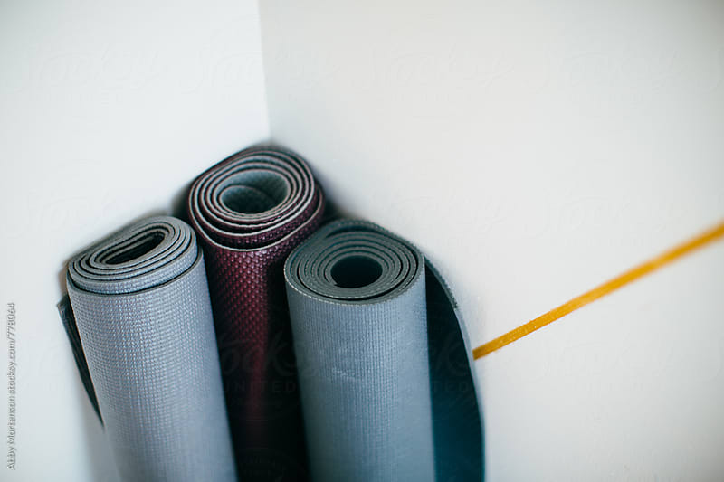 Three Yoga Mats against a Wall by Abby Mortenson for Stocksy United