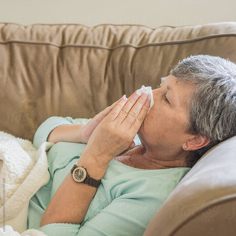 Fighting Cold and Flu Season Sickness by suzanne clements for Stocksy United