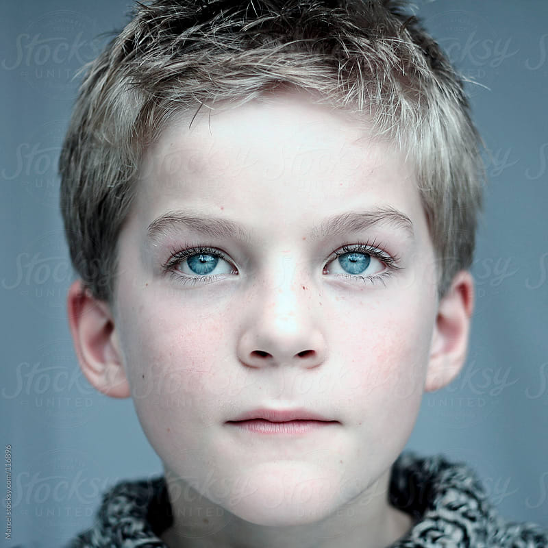 Face of an angelic boy by Marcel for Stocksy United
