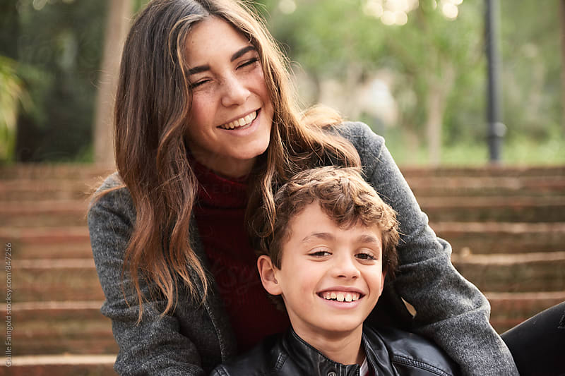 Portrait of smiling mother and son by Guille Faingold for Stocksy United