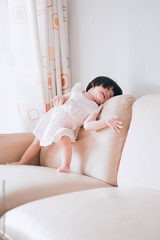 Asian baby girl by Pansfun Images for Stocksy United