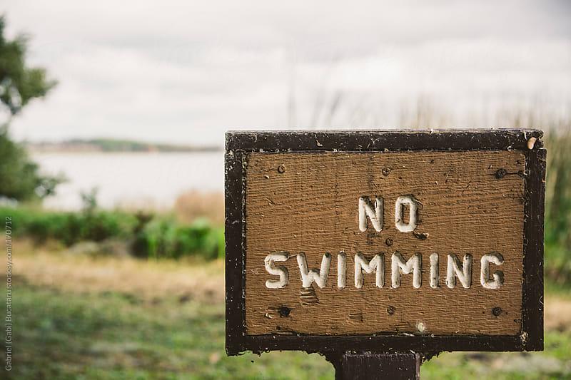 No Swimming Sign by Gabriel (Gabi) Bucataru for Stocksy United