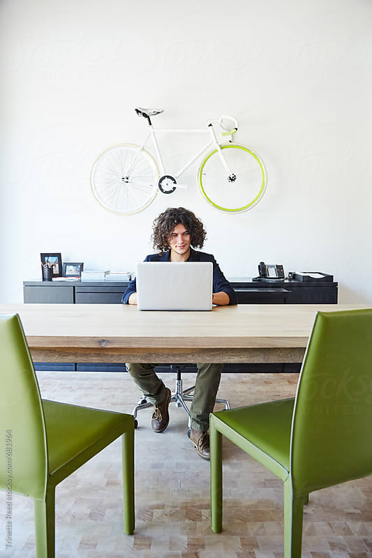 Portrait of millennial businessman in office by Trinette Reed for Stocksy United