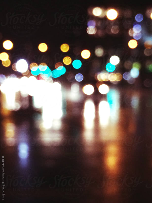 Blurred colorful bokeh lights on New York City streets at night by Greg Schmigel for Stocksy United