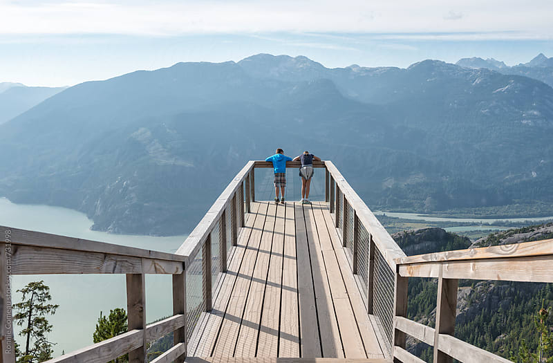 Siblings At Spectacular Mountainside Lookout by Ronnie Comeau for Stocksy United
