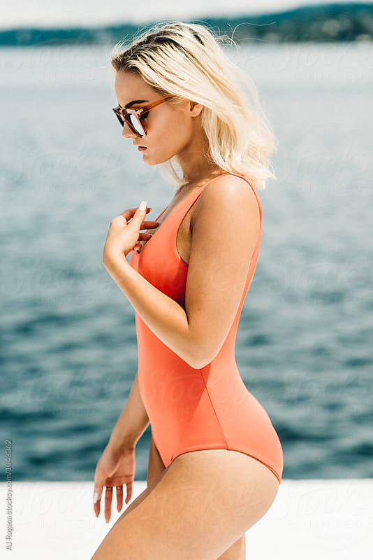 Girl in Swimsuit Relaxing under the Sun by Adrian Ragasa for Stocksy United