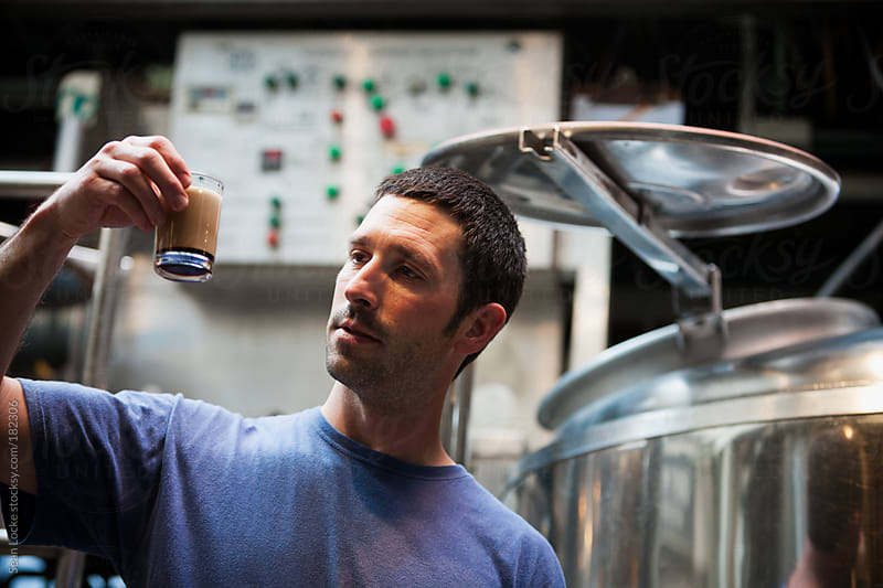 Beer: Brewer Waiting For Foam To Dissolve On Sample by Sean Locke for Stocksy United