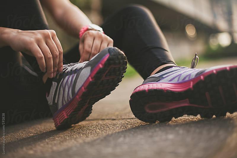 Sportswoman Tying Shoelaces by Lumina for Stocksy United