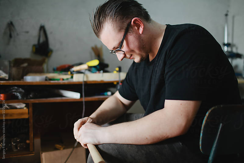 A young man working in his workshop by Sergey Filimonov for Stocksy United