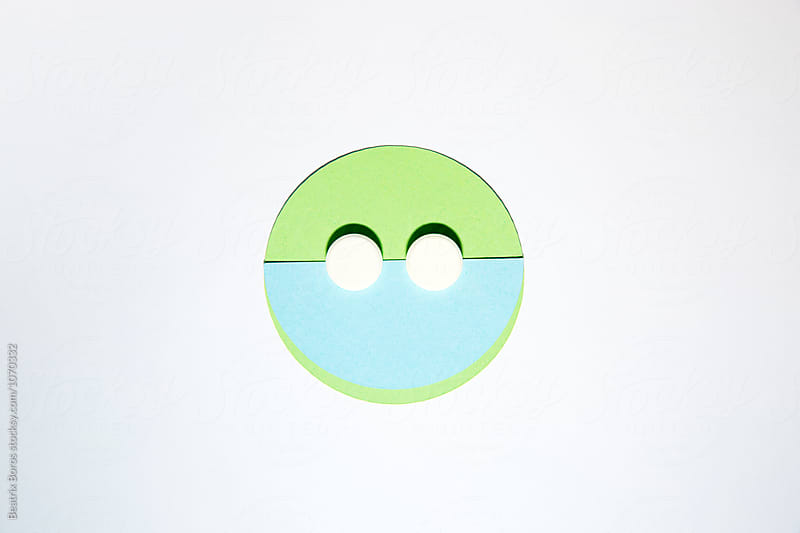 Pills and shapes creating a face with eyes by Beatrix Boros for Stocksy United