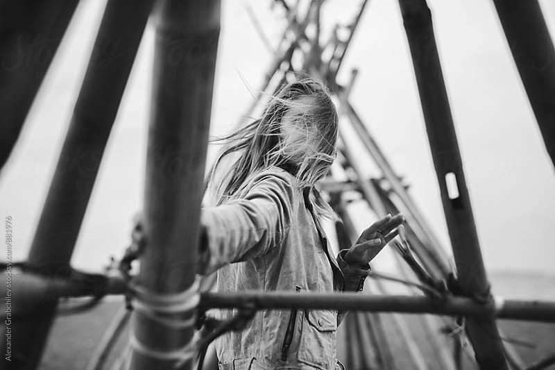 Young woman with wind in her hair by Alexander Grabchilev for Stocksy United