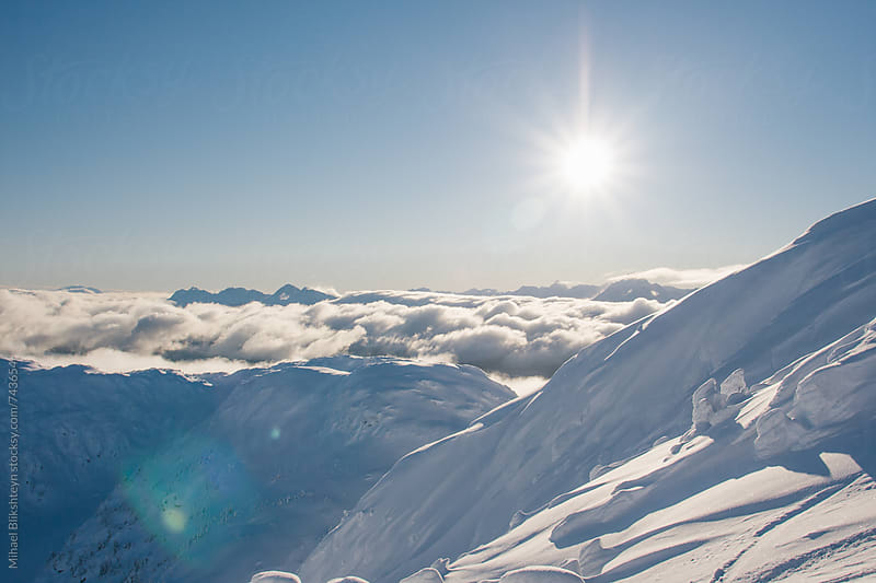 View from a mountain on a sunny winter snowy day by Mihael Blikshteyn for Stocksy United