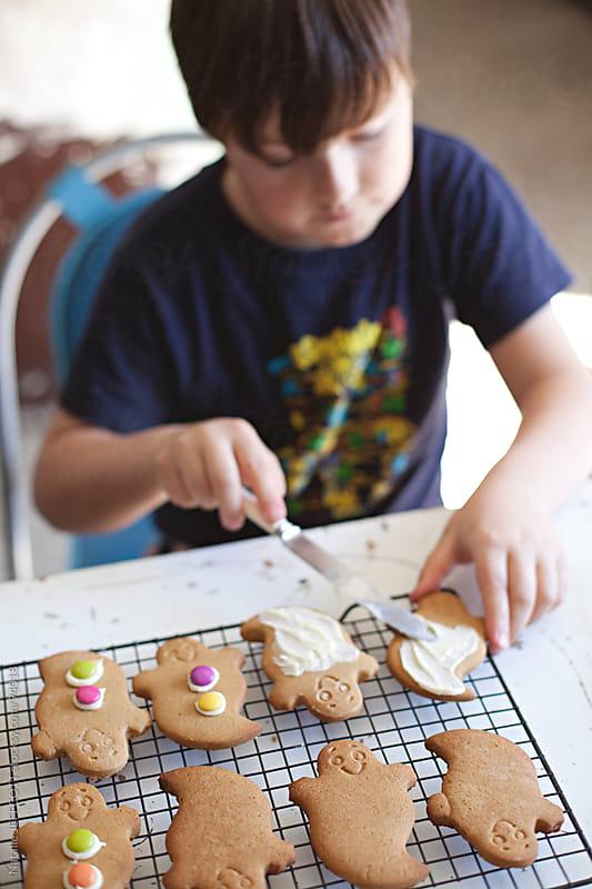 Making Halloween gingerbread cookies by Natalie JEFFCOTT for Stocksy United