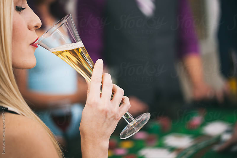 Casino: High Roller Takes Sip Of Champagne In Casino by Sean Locke for Stocksy United