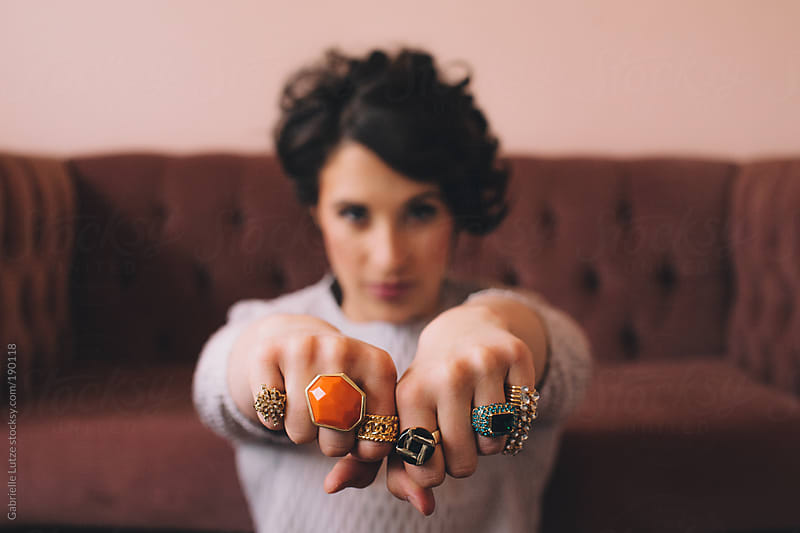 Woman Showing Off Lots of Rings by Gabrielle Lutze for Stocksy United