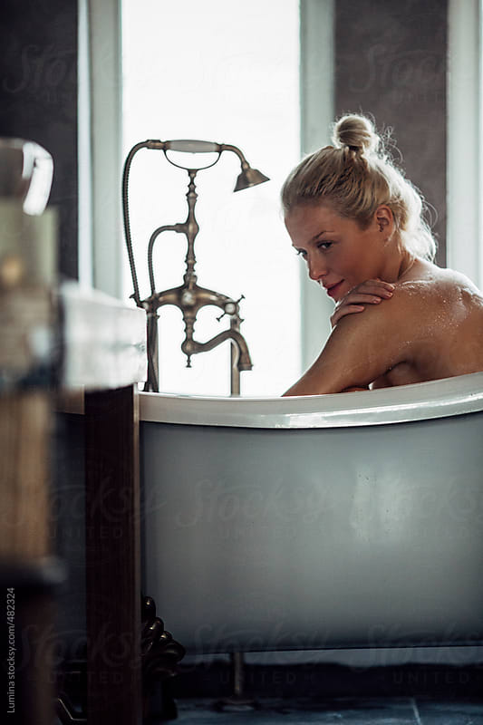 Beautiful Woman Having a Relaxing Bath by Lumina for Stocksy United
